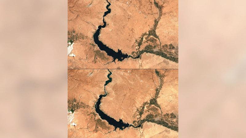 صورة من الجو لسدّ «الطبقة» على نهر الفرات في محافظة الرقة شرقي سورية حيث تتناقص كميات المياه.   أ.ف.ب