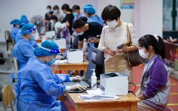 الصورة: الصين: تطعيم 969 مليون شخص ضد كورونا