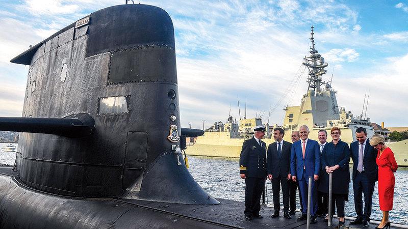 الرئيس الفرنسي إيمانويل ماكرون في زيارة سابقة لأستراليا إثر اتفاق زعيمي البلدين حول صفقة الغواصات. غيتي