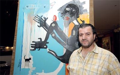 الريس وزع لوحاته في العالم ليزرع الفن في كل بيت.تصوير: أشوك فيرما