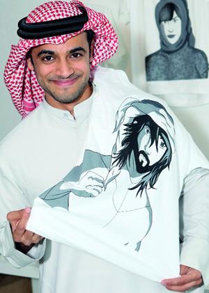 خالد بن حمد وإحدى شخصيات قصصه المصورة.  تصوير: تشاندرا بالان