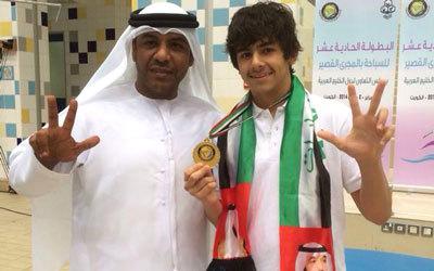 عبدالله مبارك مع السباح خالد حوسني. من المصدر