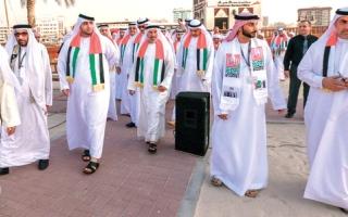 راشد بن حمدان يتقدم مسيرة بحرية احتفالاً بـ«اليوم الوطني»
