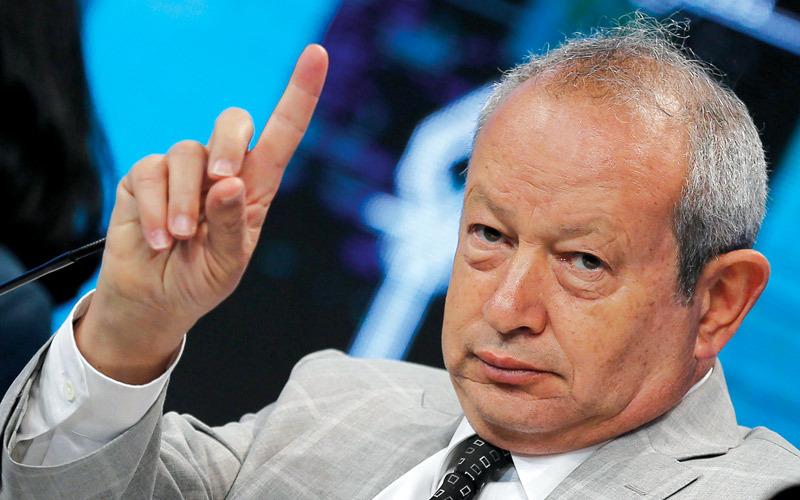 ساويرس متهم بممارسة نفوذه المالي على الحزب.  رويترز
