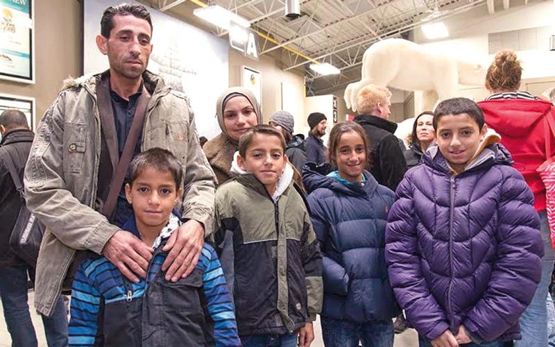 لاجئون سوريون يتلقون ترحيباً حاراً في شمال كندا