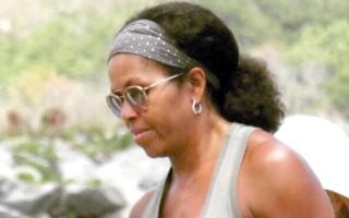 صورة لميشال أوباما   بـ«شعرها الطبيعي» تحظى  بانتشار واسع على الإنترنت